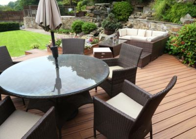 a patio dinning set positioned on top of a Trex deck