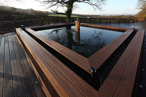A Trex Composite Deck with a raised pond