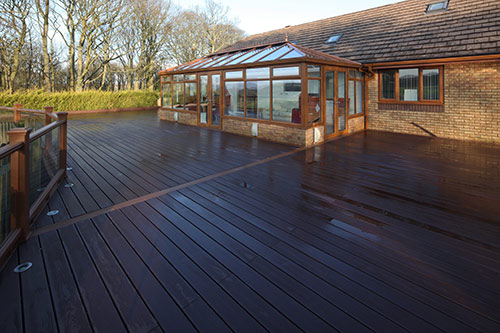 Trex Composite Decking with conservatory in the background